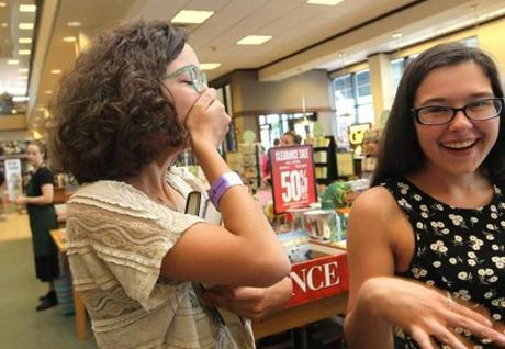 Maria Ferraguto, 16, of Woburn and friend Meaghan Angers, 11, got their books signed.
